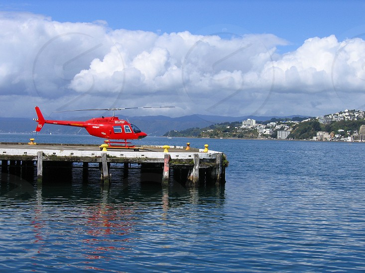 Helicopter on seaside wharf with cloudy skies. photo