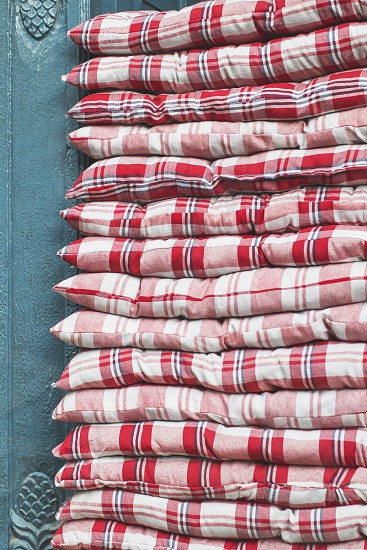 Red and white checkered blankets in the stack photo