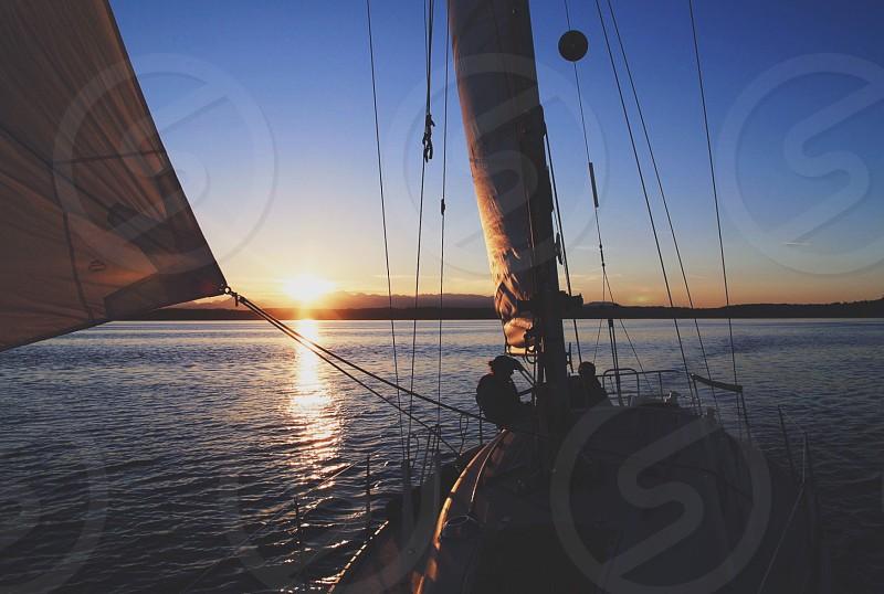 Sailing sunset boating pnw puget sound wind sea Olympics photo