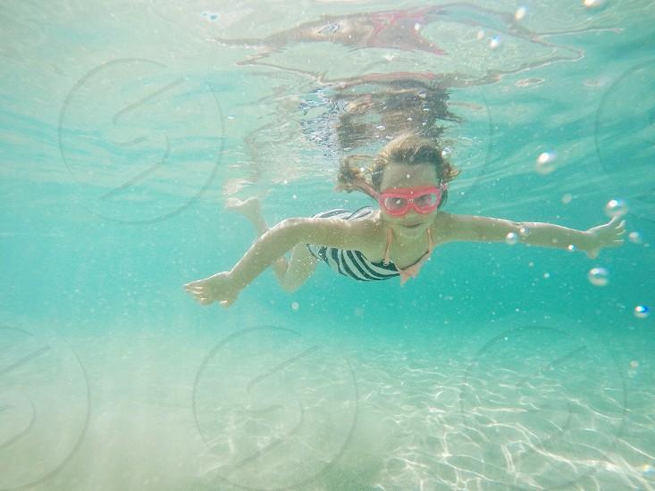 girl swimming under water photo