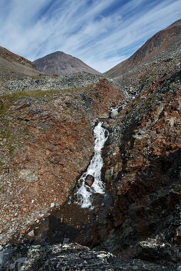 Beautiful Kamchatka mountain landscape: view of mountain river into steep cliffs on a sunny day. Kamchatka Region Russian Far East Eurasia. photo