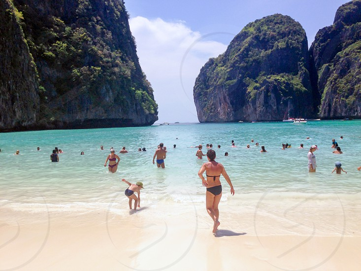 Limestone mountains and white sandy beach with crystal clear seawater at Maya Bay on Ko Phi Phi Le Islands Krabi Thailand photo
