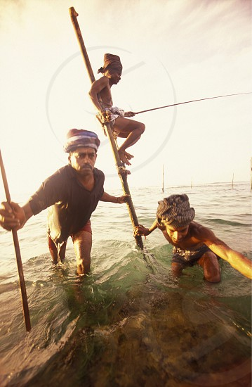 Fishermen at the coast of Weligama in the southwest of Sri Lanka in Asien. photo