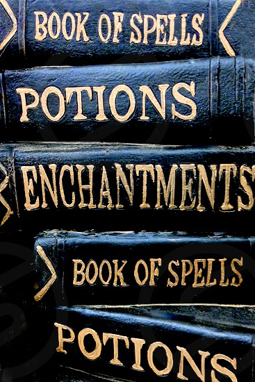 Pile of a witch's  books about enchantments spells and potions photo