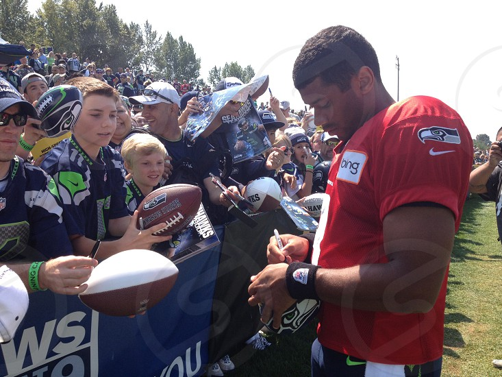Russell Wilson of the Seattle Seahawks signing for fans after traning camp at the VMAC [image taken august 2013 as guest instagrammer for Seattle Seahawks] photo
