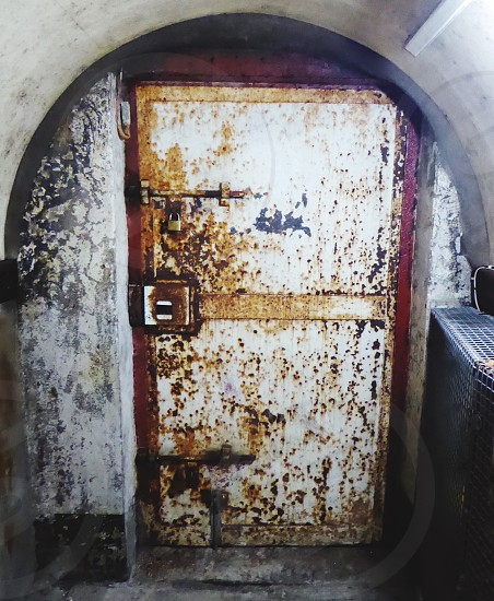 Old door Rust Belfast Northern Ireland Crumlin Road Gaol Arch Old Locked Tunnel End of Tunnel. photo