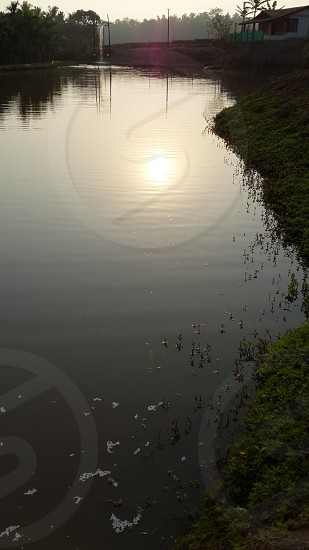 Sunrise shot reflecting through the waters photo