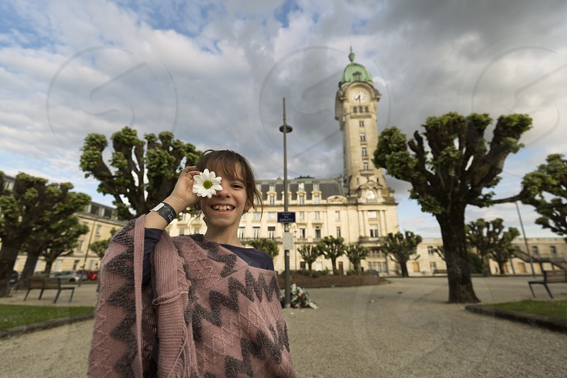 11-year-old Spanish girl in front of the Limoges station in France. photo