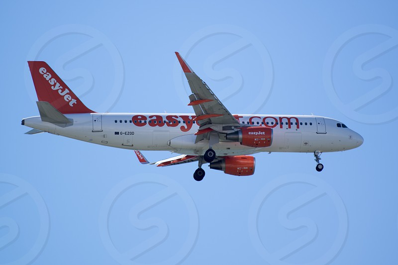 a airplane of easyjet landing at the Faro airport at the east Algarve in the south of Portugal in Europe. photo