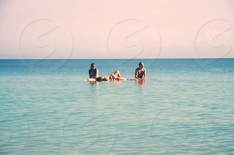 Friends sitting on water photo