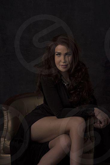Black dress female looking at camera elegant attractive  photo