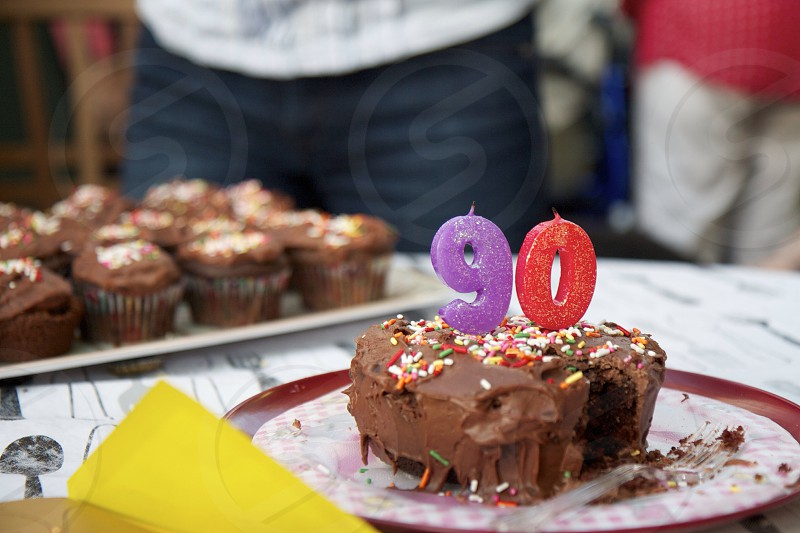 brown muffins with 9 and 0 candles photo