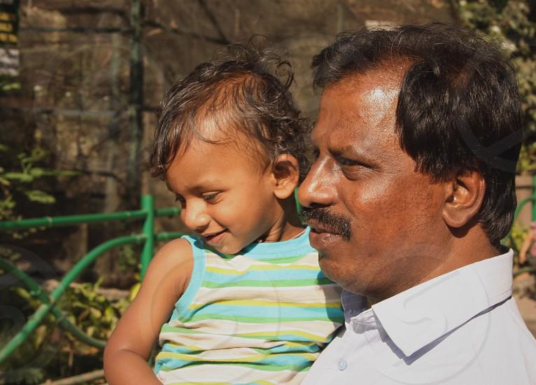 FathersonfamilyIndianparentingkidchildhappysmile photo