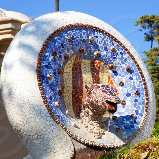 Barcelona Park Guell of Gaudi Snake and four Catalan bars in modernism mosaic photo