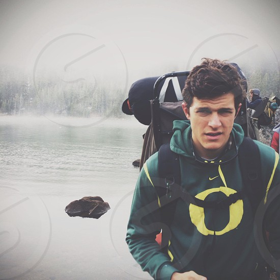 man wearing an oregon hoodie carrying a backpack photo