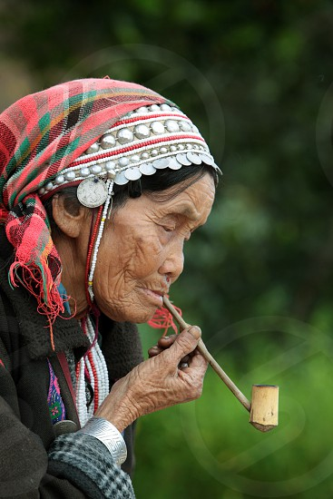 old women of the minority of Akha near  the village of Fang in the north of chiang mai in the north of Thailand in Southeastasia.  photo
