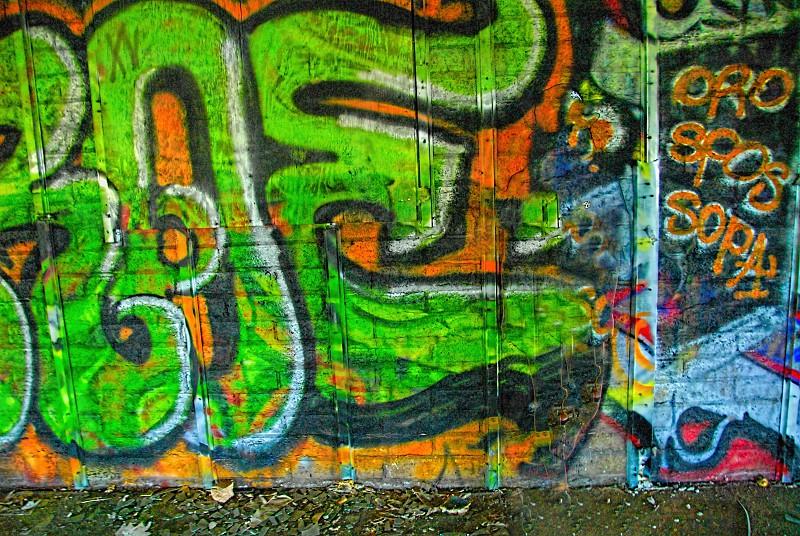 Colorful graffiti covers an urban city wall photo