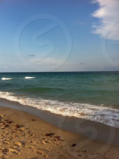 beach sand ocean photo