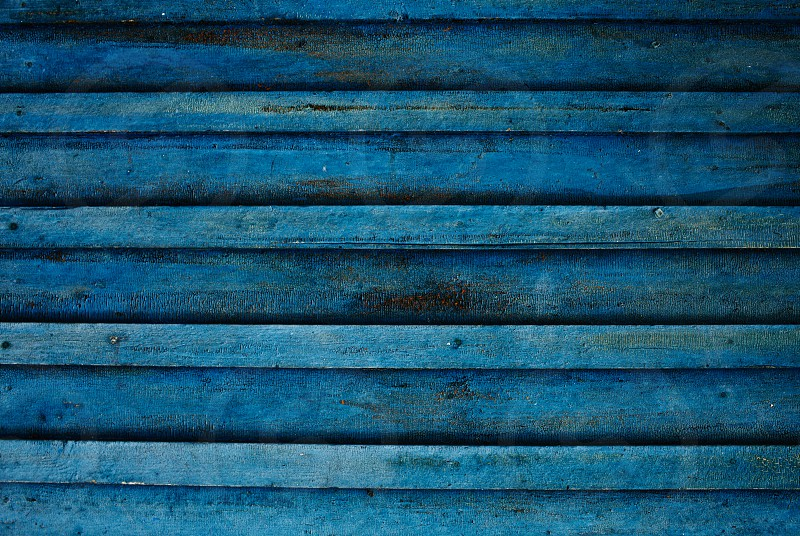 Old blue dirty wooden wall. High quality image great for backgrounds and modern grunge designs. photo