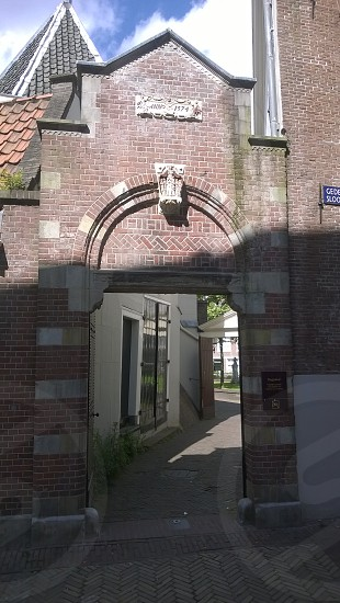 This is the entrance to the Begijnhof in Amsterdam. It is one of the oldest inner courts in the city of Amsterdam. photo