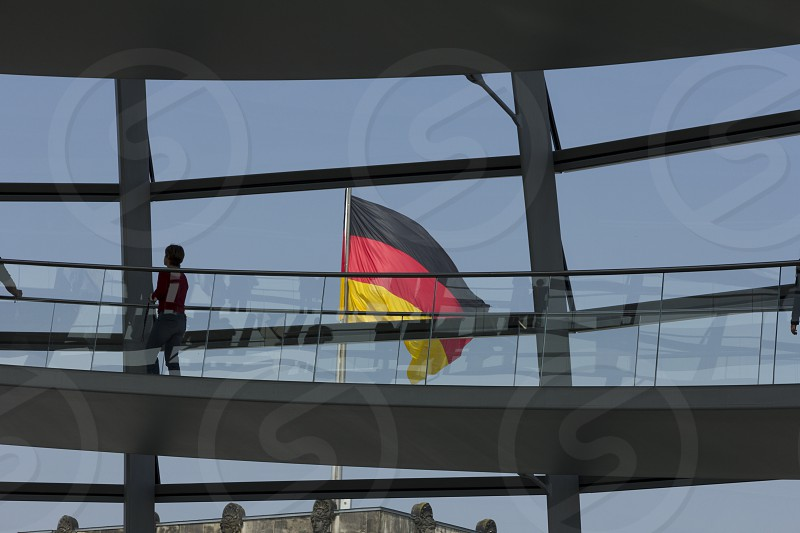 German flag on the Reichstag Gebäude in Berlin Germany. photo
