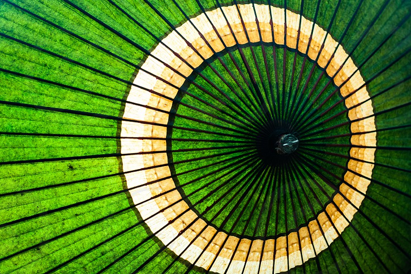 Top of a parasol open to the sun photo