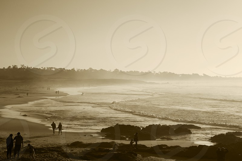 Late afternoon stroll at California beach  photo