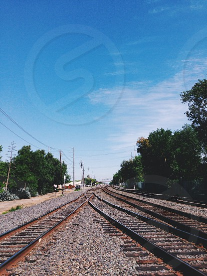 train tracks under blue skies photo