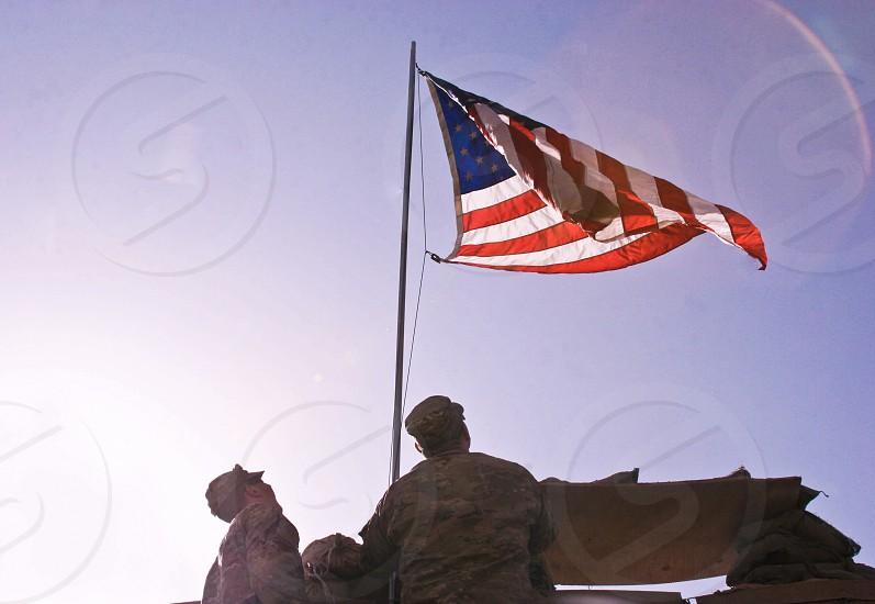 soldiers raising american flag photo