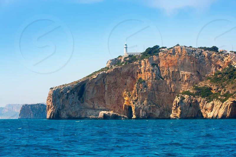 Cabo de la Nao Cape lighthouse in mediterranean sea Alicante Spain photo