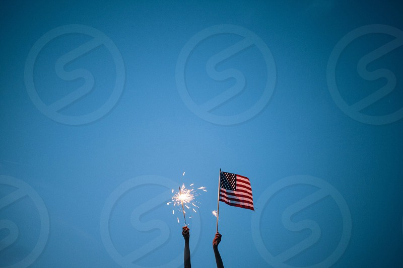 Fourth of July; sparkler and American flag photo