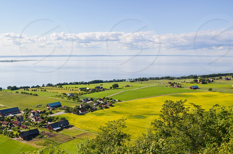 travel europe sweden countryside lake clouds flowers fields farms photo