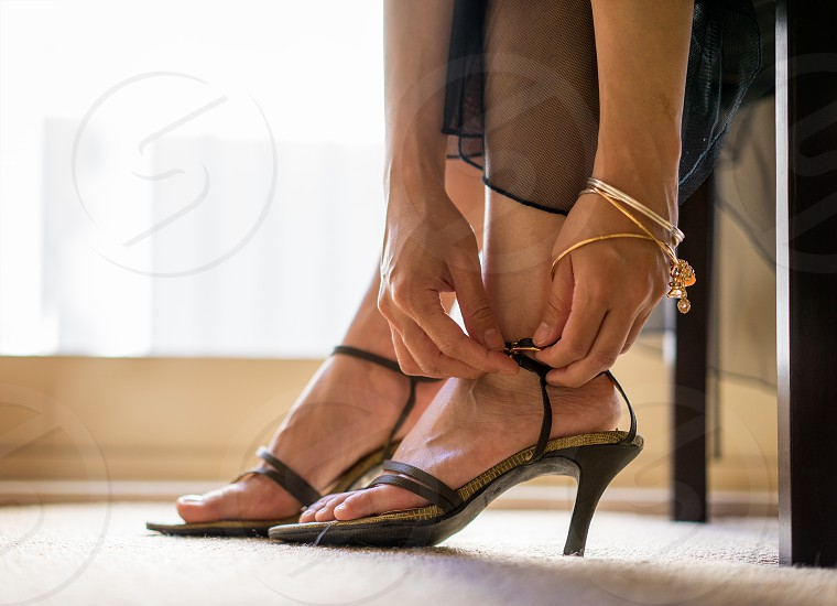 woman wearing black strappy sandals photo