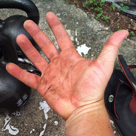 Workout Fitness Kettle bell HIIT hand self portrait.  photo