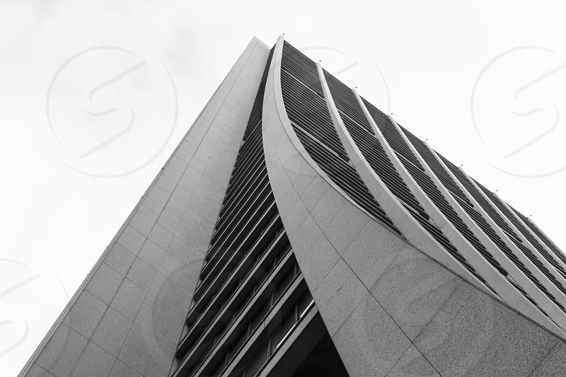 Looking up a curving building exterior in Chicago IL photo