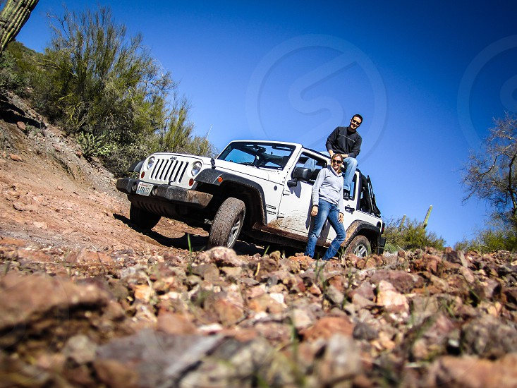 Off-roading in the Arizona desert. Jeep red rock young travelers adventure. photo