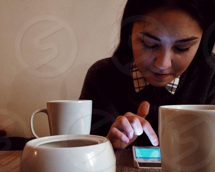 woman looking at a phone photo