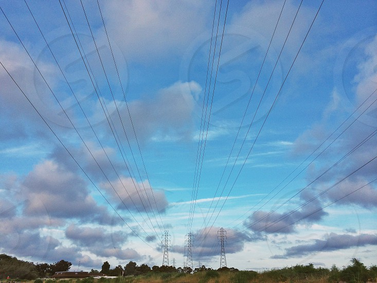 electric wire cable with cloudy sky photo