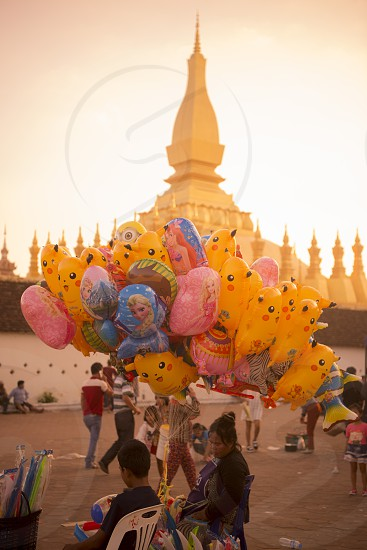 a Balloon saler at the Pha That Luang Festival in the city of vientiane in Laos in the southeastasia. photo