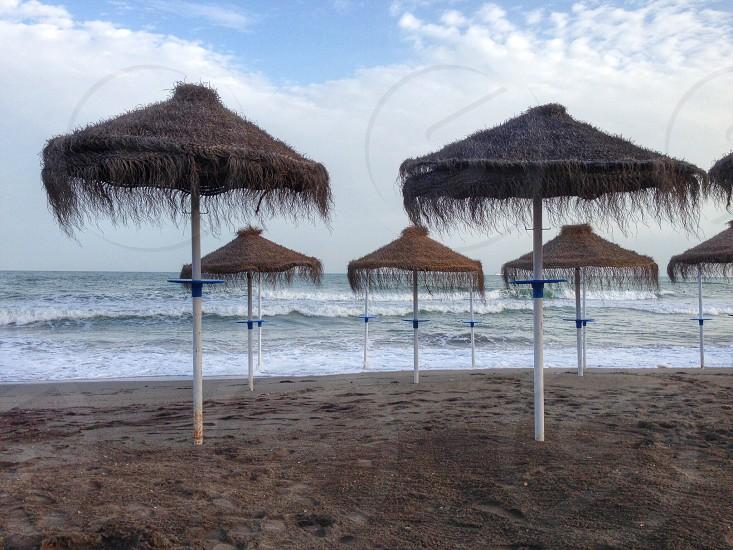 Ocean beach umbrellas scene sea photo