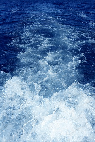Boat wake foam water propeller wash blue saltwater photo