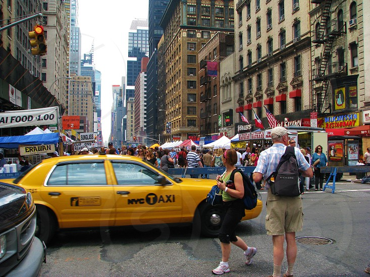 NYC New York Manhattan taxi cab people street culture event Broadway street fair Big Apple midtown photo