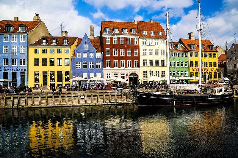 Reflection water Copenhagen Denmark ship nyhavn colorful architecture buildings culture houses photo