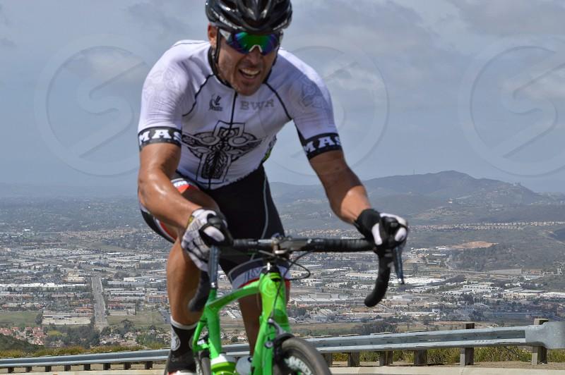 man riding a bicycle photo