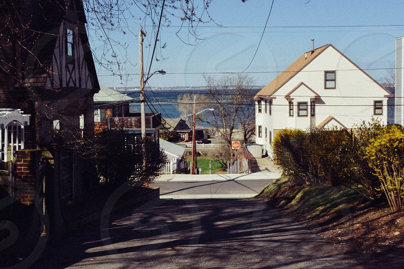 view between houses of street photo