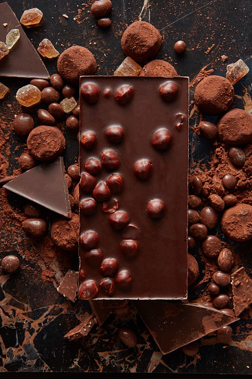 Chocolate and sweets isolated on black background photo