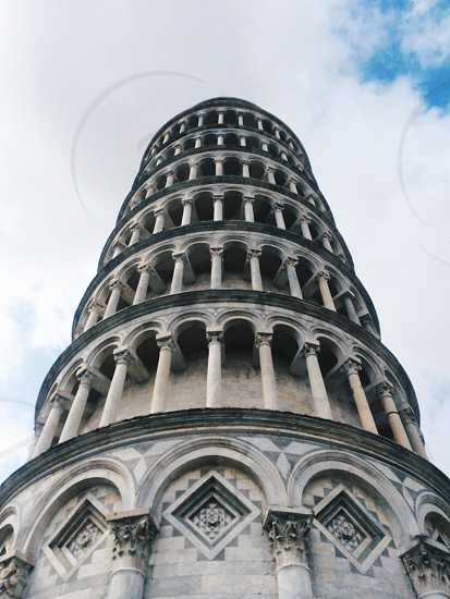 leaning tower of pisa under white cloudy blue sky during daytime photo