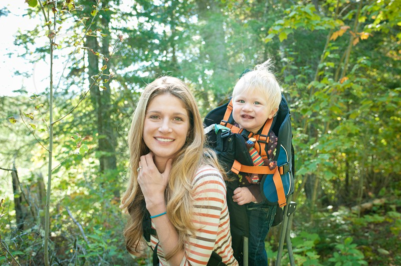 family active hiking mother son backpack walking forest fun woods trail camping boy child mom hair blonde trees leaves summer happy smile photo