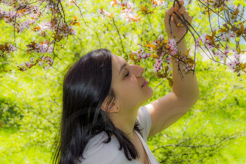 freedom nature girl woman smell flower green photo