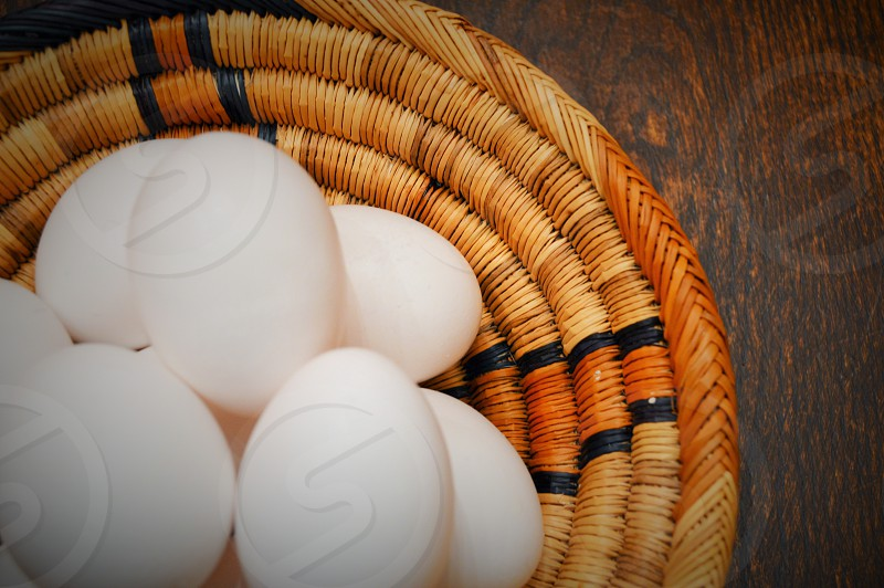 8 eggs on brown knitted round table mat photo